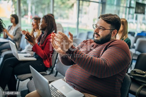 505413934 istock photo Applauding on a business seminar! 1143481431
