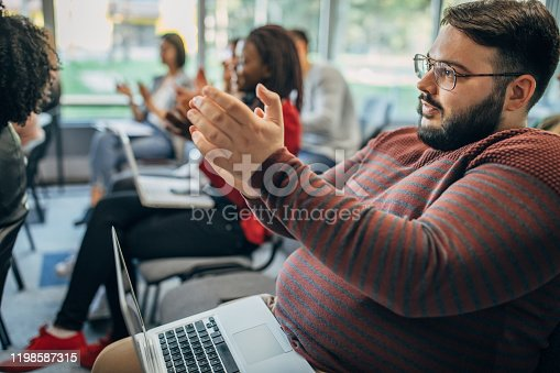 505413934 istock photo Applauding on a business seminar! 1198587315