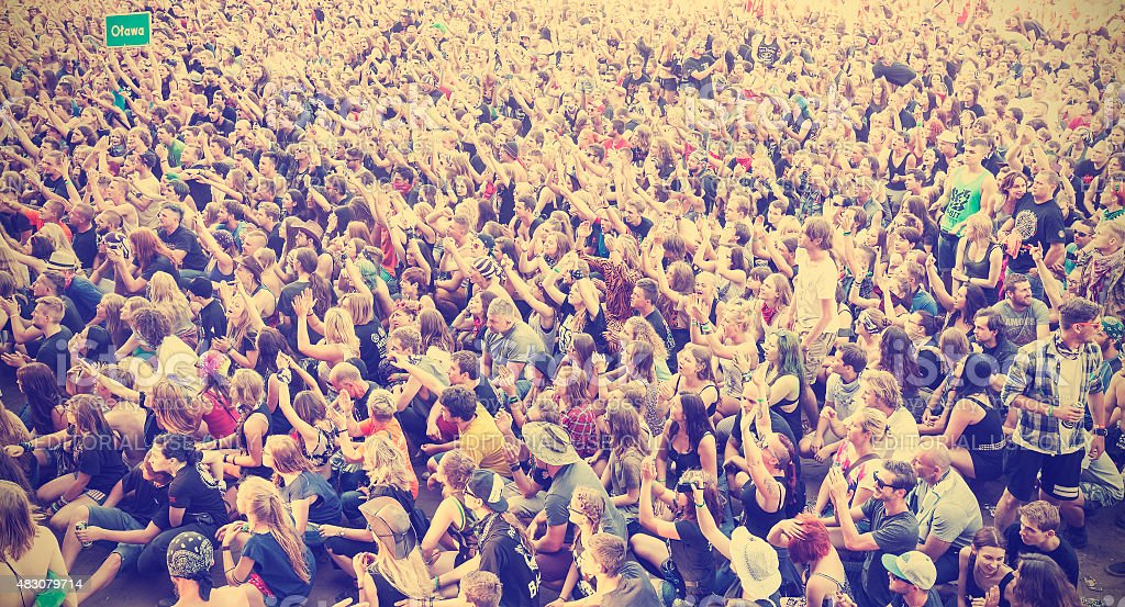 Applauding people during concert on the 21th Woodstock Festival Poland, stock photo
