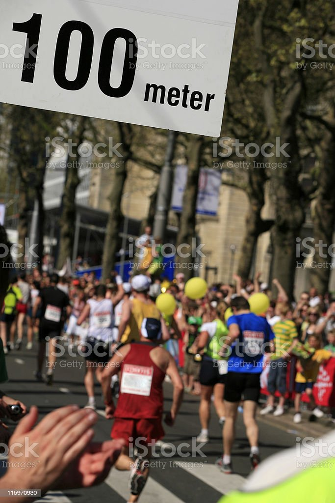 applauding spectators at the finish of a distance run royalty-free stock photo