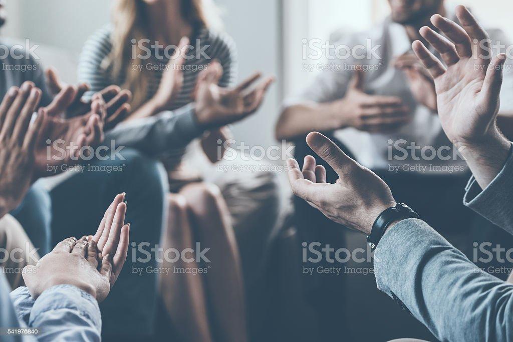 Applauding their success. - Photo de Affaires libre de droits