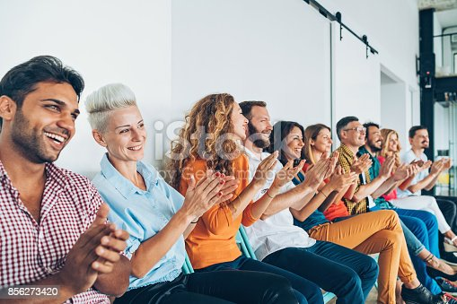 858148040 istock photo Applaudingm audience 856273420