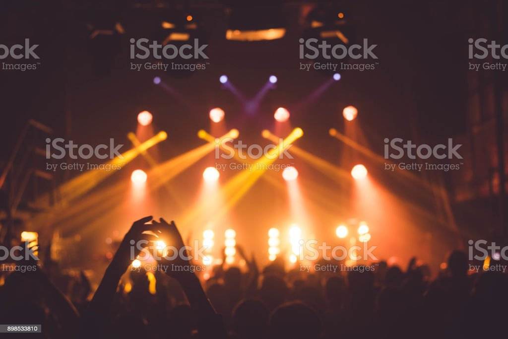 applause and raised hands at concert. Nightclub life stock photo