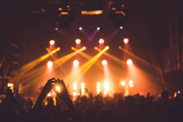 applause and raised hands at concert. nightclub life - arts culture and entertainment stock pictures, royalty-free photos & images