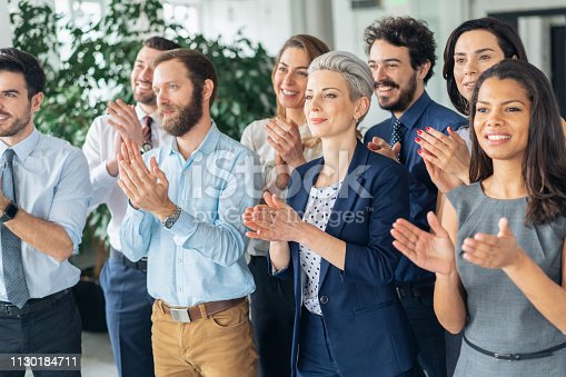 1180918029 istock photo Applause At Business Conference 1130184711