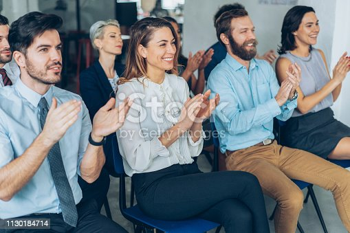 1180918029 istock photo Applause At Business Conference 1130184714