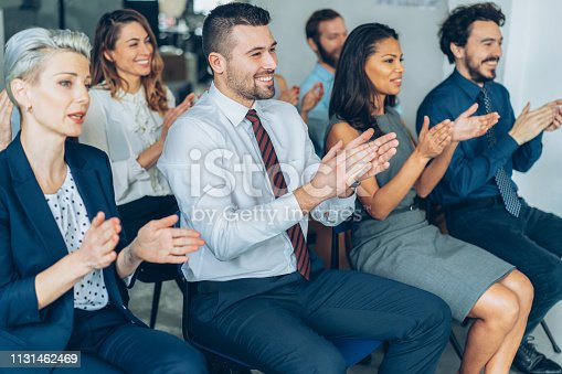 1180918029 istock photo Applause At Business Conference 1131462469