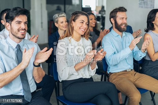 1180918029 istock photo Applause At Business Conference 1141707530
