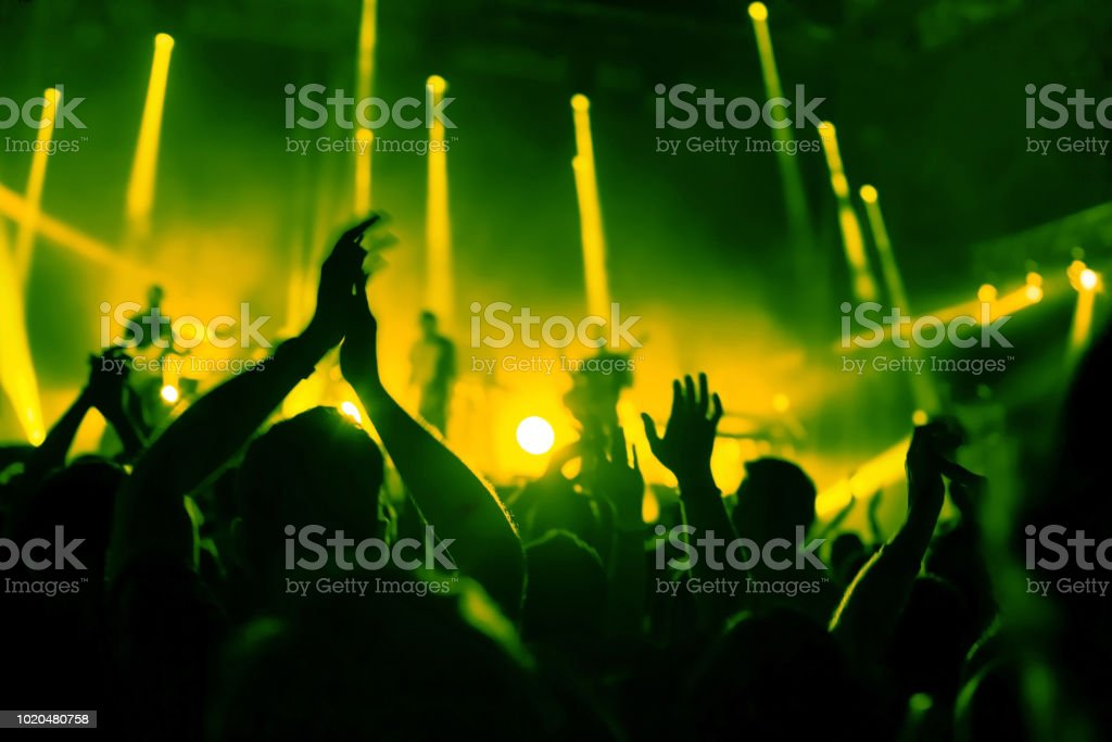 applause, crowd of people applauding to musicians at music festival stock photo