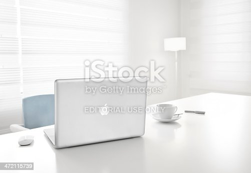 Istanbul, Turkey - January 1, 2012: A MacBook Pro laptop computer by Apple Inc. on a office table. This MacBook Pro has a 17-inch antiglare widescreen display and is running the OS X Snow Leopard 10.6.3 operating system.