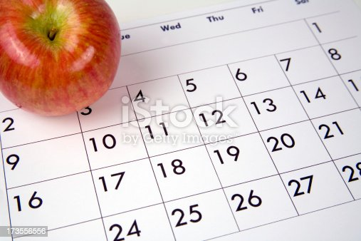 Apple on calender. An apple a day keeps the doctor away.