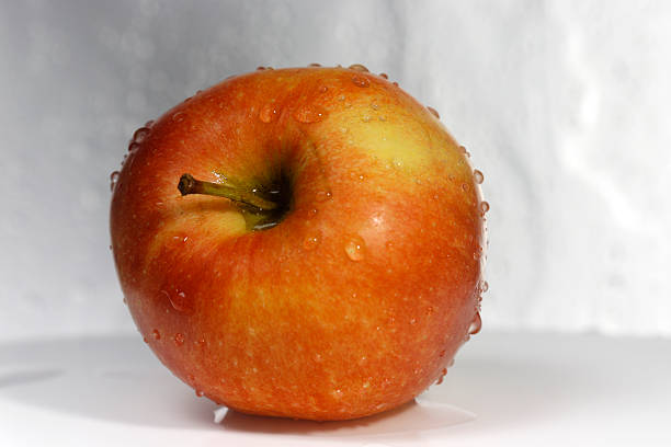 Apple after the wash with front view stock photo