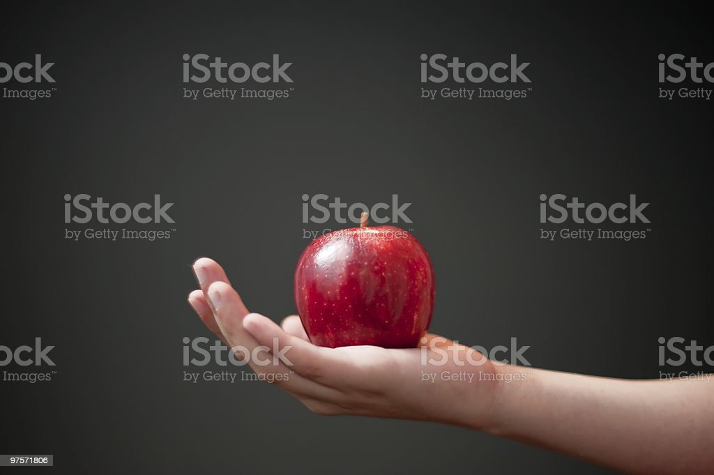 Apple against black background royalty-free stock photo