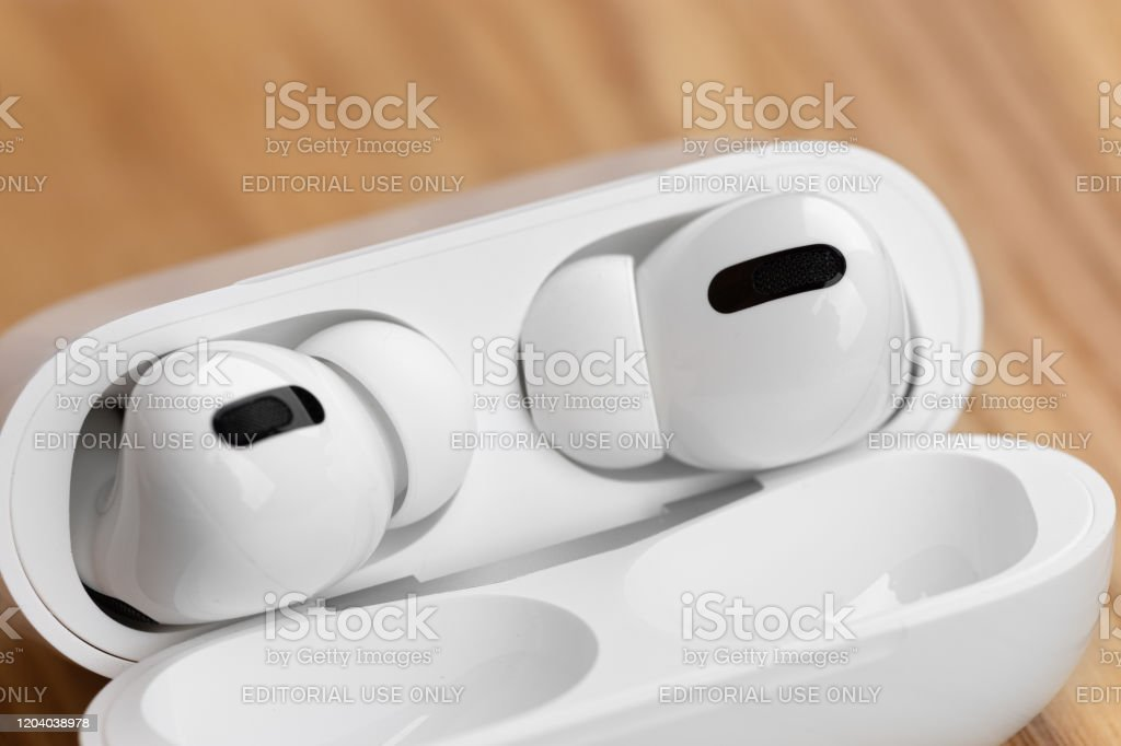 Apple Airpods Pro On A Wooden Table Stock Photo Download Image