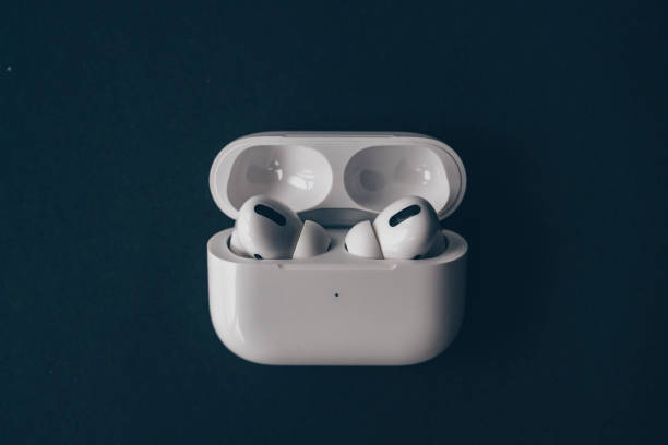 Apple AirPods wireless bluetooth headphones and charging case stock photo