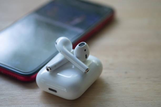 Samut Prakan, Thailand - June 21, 2020 : Apple AirPods wireless headphone with charging box. Use with Iphone, Ipad or Mac. Samut Prakan, Thailand - June 21, 2020 : Apple AirPods wireless headphone with charging box. Use with Iphone, Ipad or Mac. wireless headphones stock pictures, royalty-free photos & images