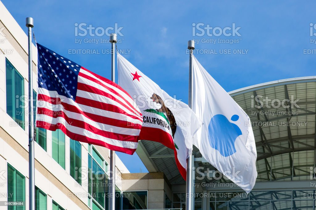 Apple, American and California flags in front of the Apple headquarters in Cupertino, CA stock photo