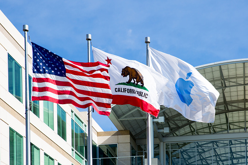 istock Apple, American and Californian flags in front of the Apple headquarters in Cupertino, CA 949299532