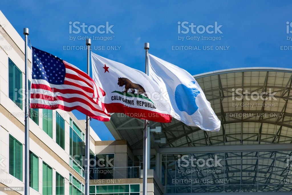 Apple, American and Californian flags in front of the Apple headquarters in Cupertino, CA stock photo