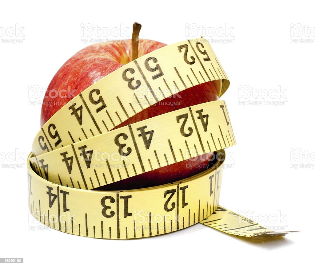 Apple and a tape measure isolated on white royalty-free stock photo
