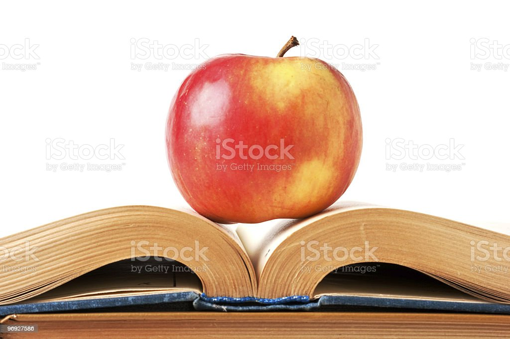 apple and an open book royalty-free stock photo