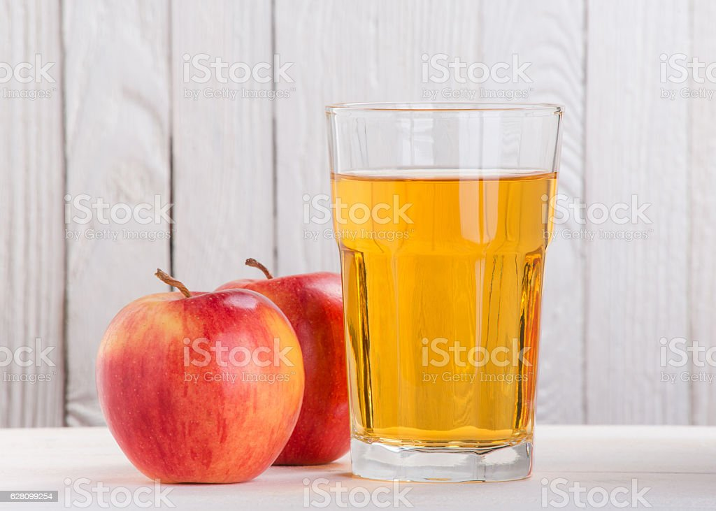 apple and apple juice in a glass stock photo