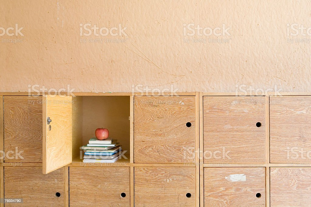 Apple and books in a locker royalty-free stock photo