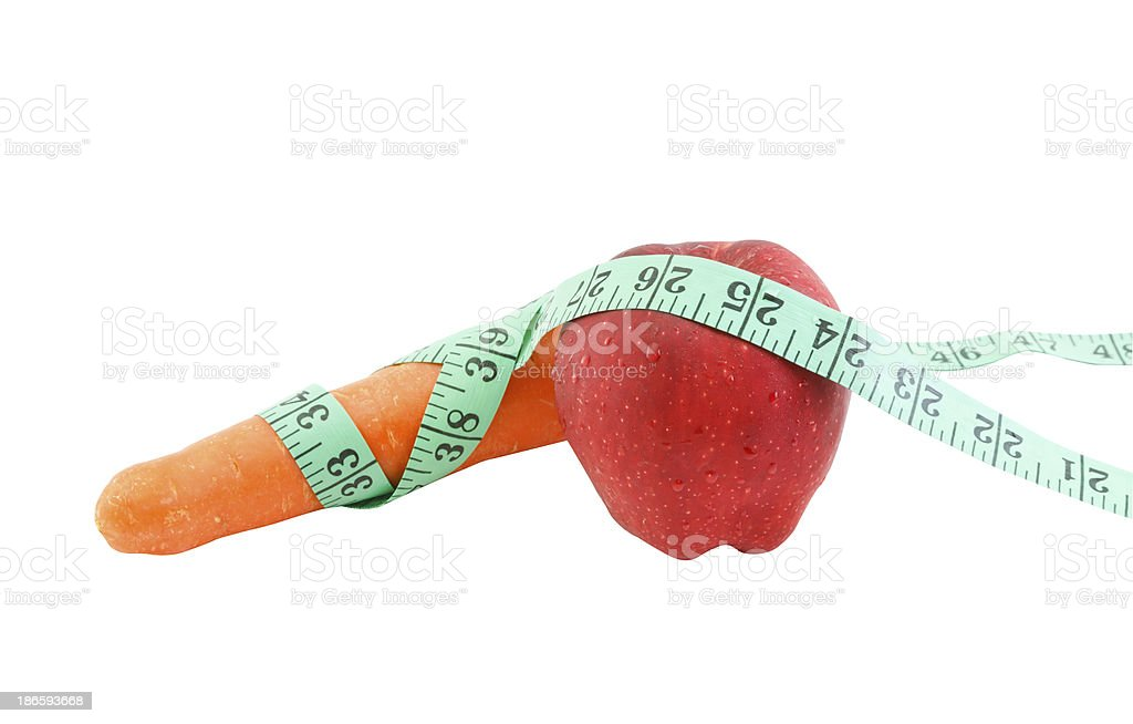 apple and carrot with measuring tape on white background royalty-free stock photo