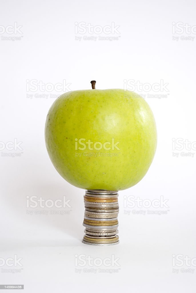 apple and coins royalty-free stock photo