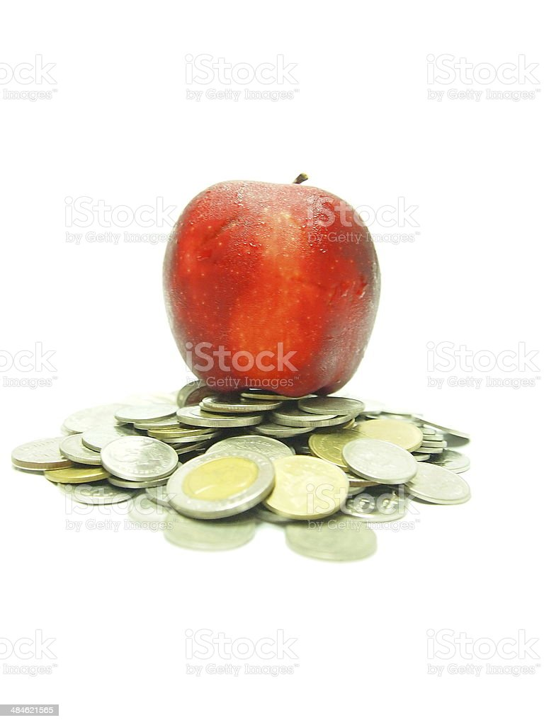 Apple and Coins stock photo