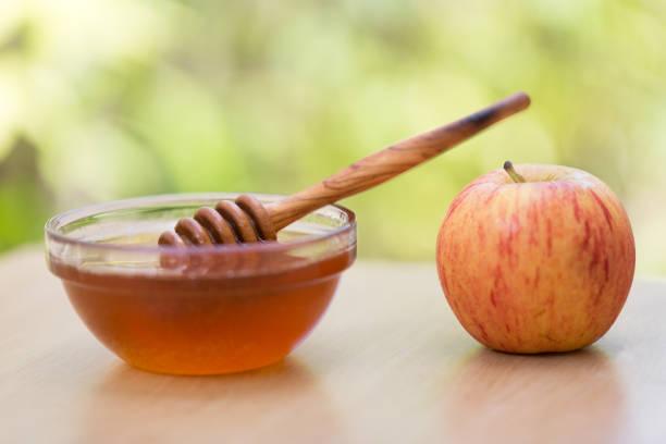 Apple and honey for Rosh Hashana stock photo