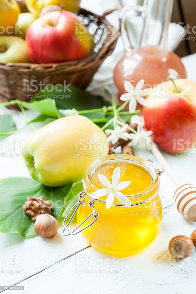 Apple and honey on light wooden table royalty-free stock photo