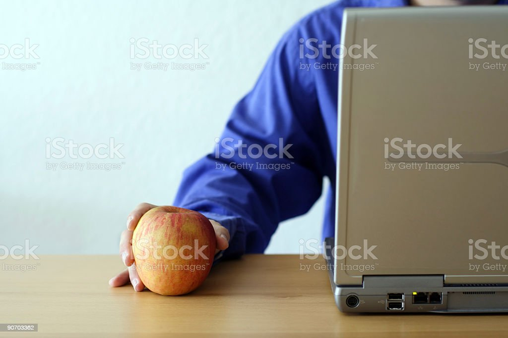 Apple and laptop royalty-free stock photo