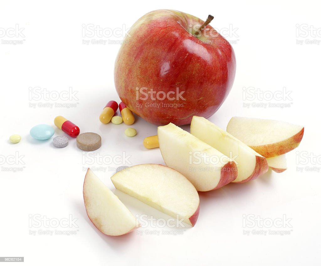 apple and medical tablets royalty-free stock photo