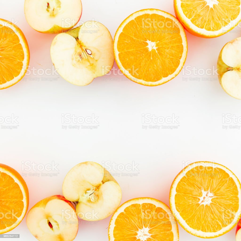 Apple and orange citrus on white background. Flat lay. Food frame with fruits zbiór zdjęć royalty-free