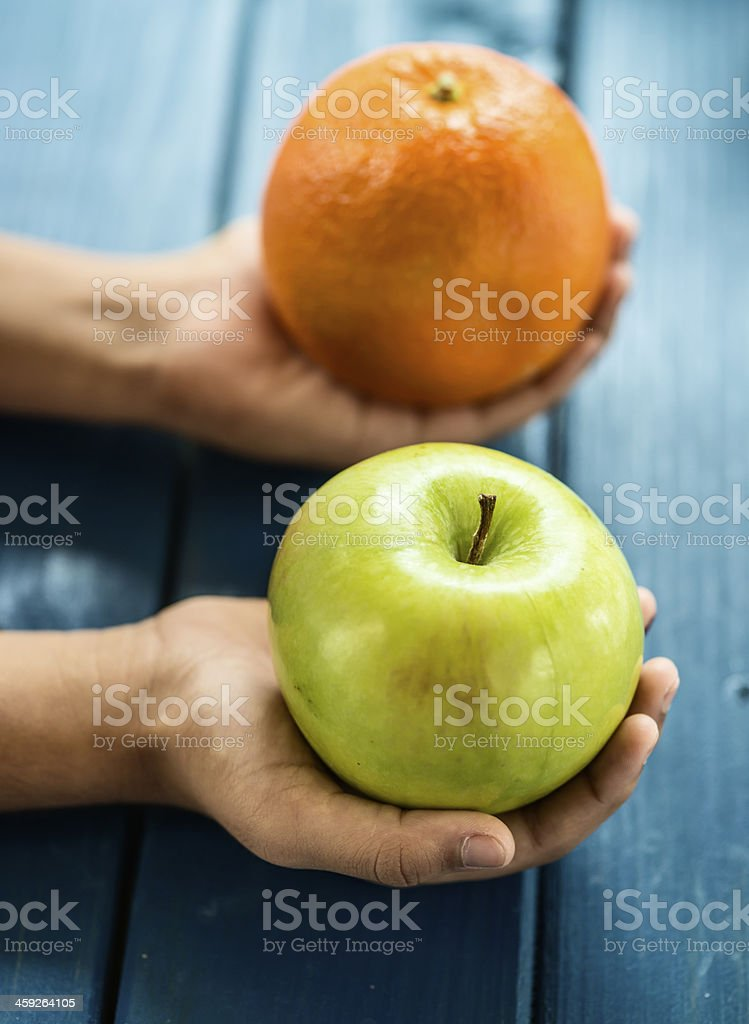 Apple and orange comparison stock photo