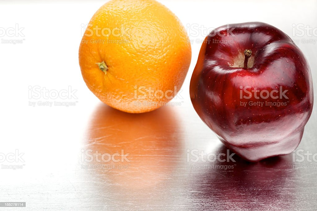 apple and orange fruit on silver platter stock photo