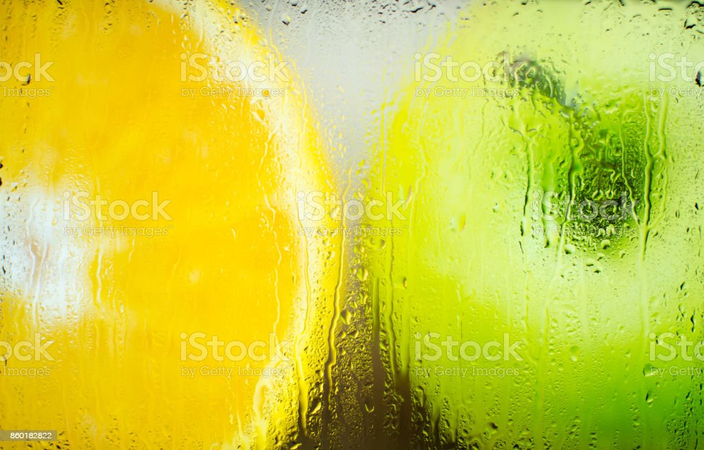 Apple and orange in a frosted glass stock photo