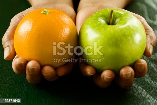 Comparing apple to orange exhibiting the idea of comparing two completely different things