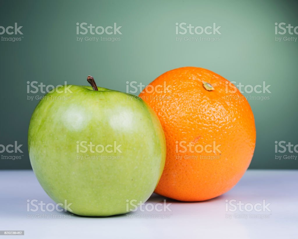 Apple and oranges comparison stock photo