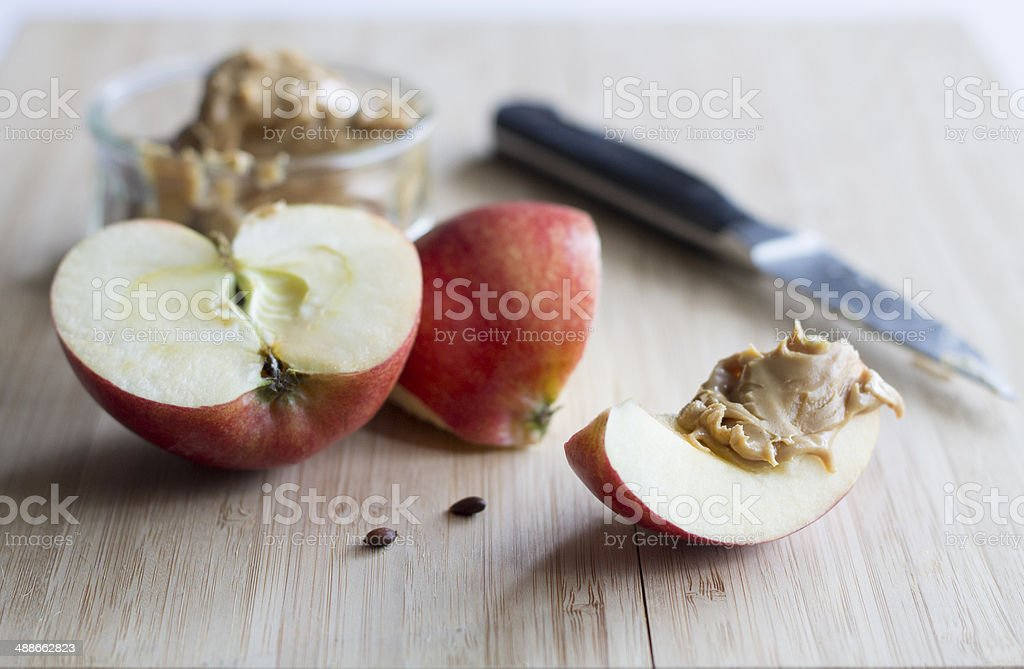 apple and peanut butter stock photo