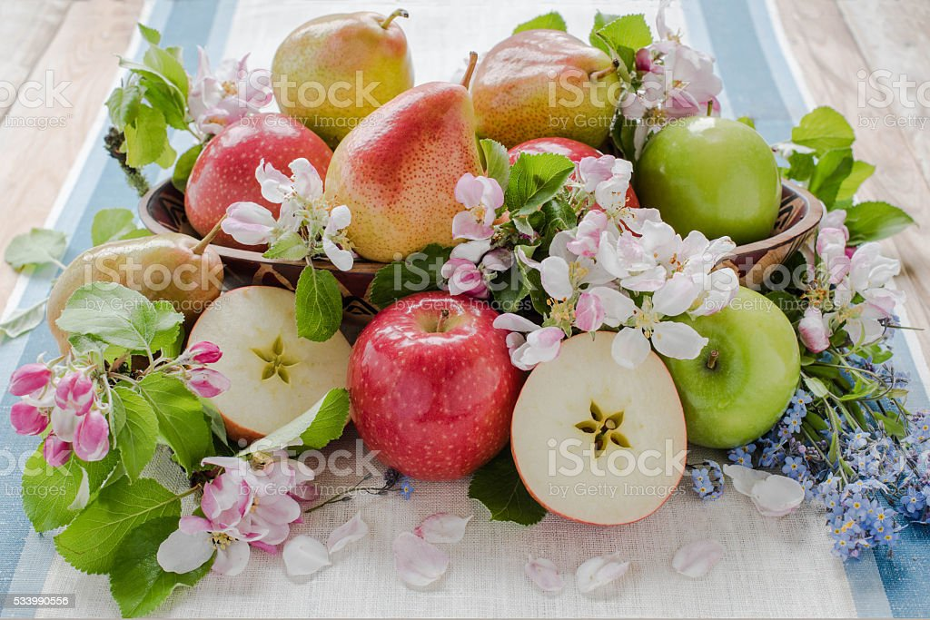 Apple and pears in spring composition – zdjęcie