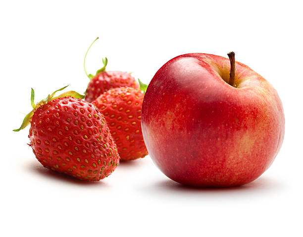 Apple and ripe strawberry on white stock photo