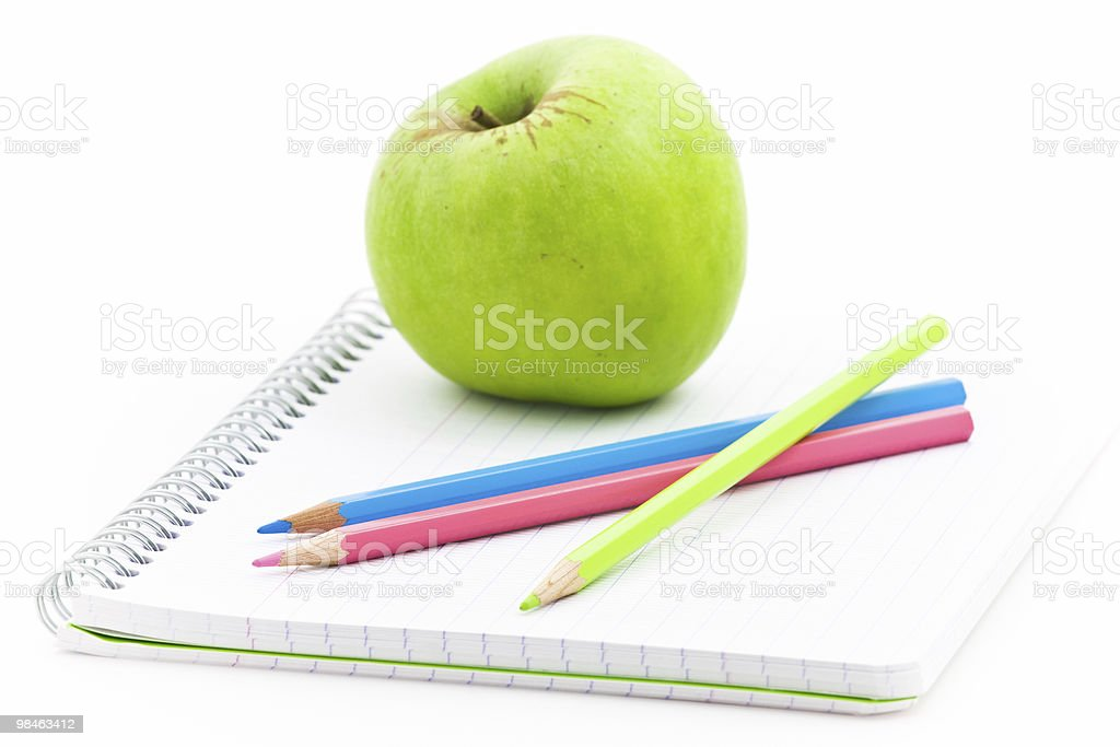 Apple and spiral notebook royalty-free stock photo