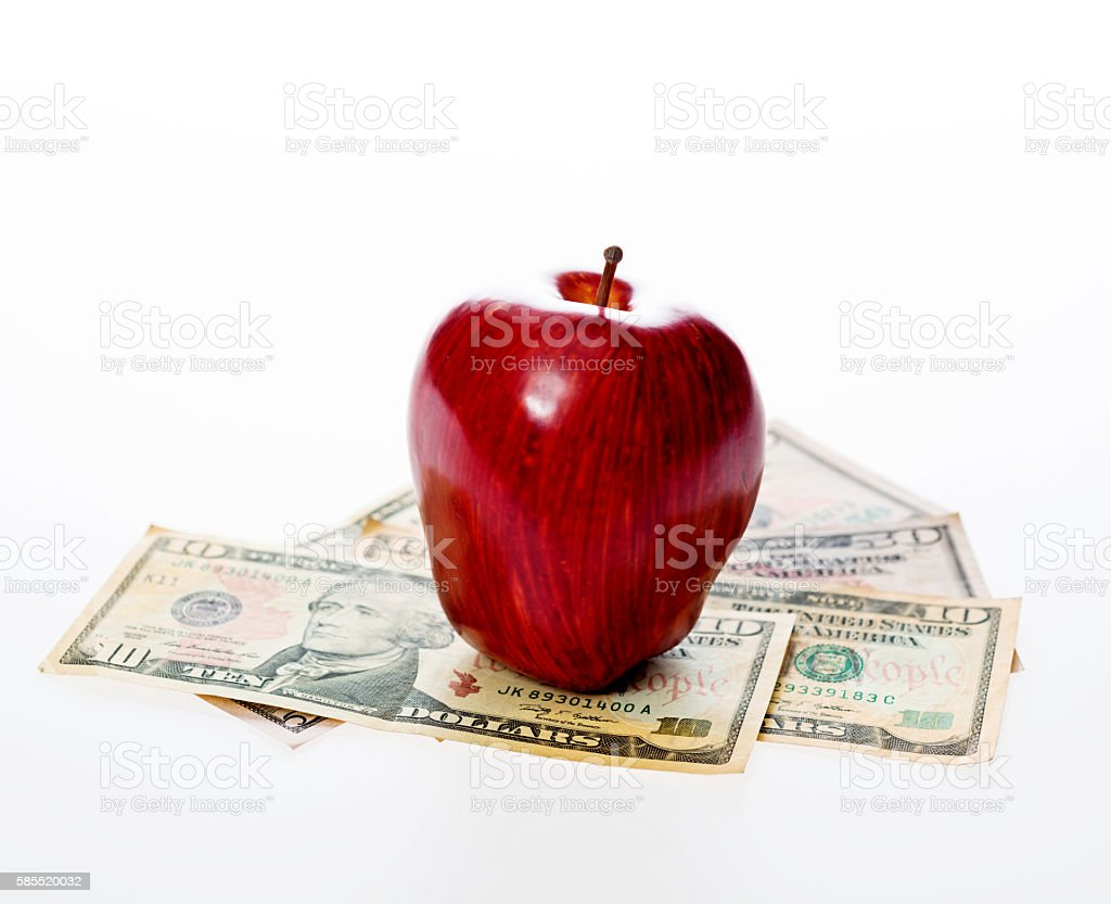 Apple and us currency stock photo