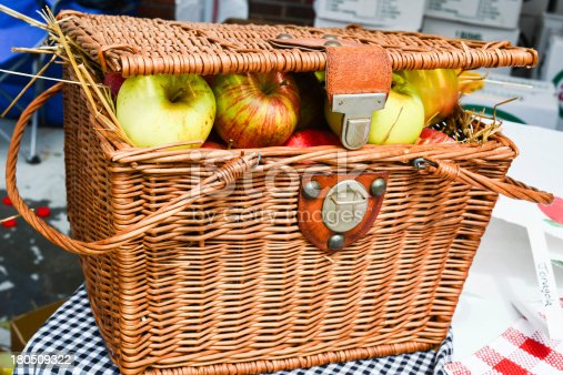 Wicker basket packed with fresh apples