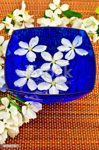 istock Apple blossom in the blue cup of water 465662801