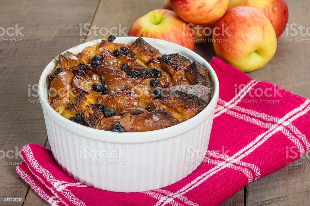 Apple bread pudding with raisins stock photo
