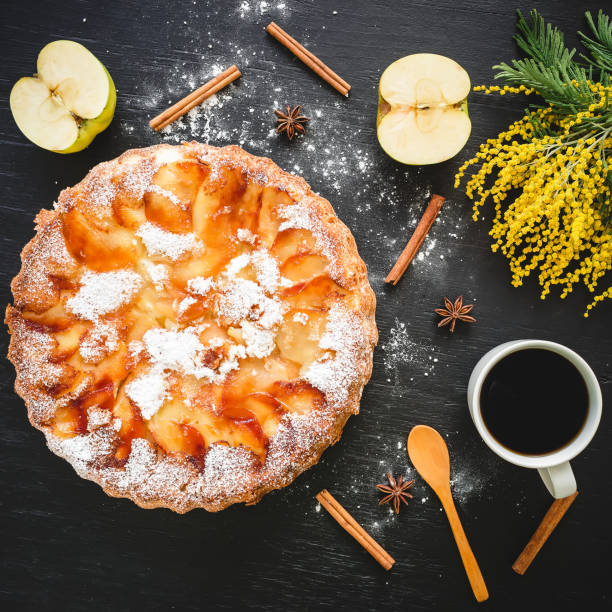 apple cake, fruits and coffee cup on dark background. flat lay, top view. - mimosa cake foto e immagini stock