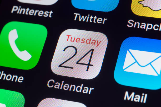 Apple Calendar, WhatsApp, Mail and other phone Apps on iPhone screen stock photo